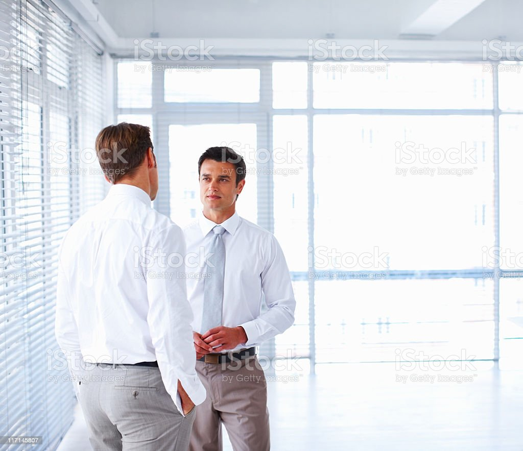 Male executives discussing business strategy royalty-free stock photo