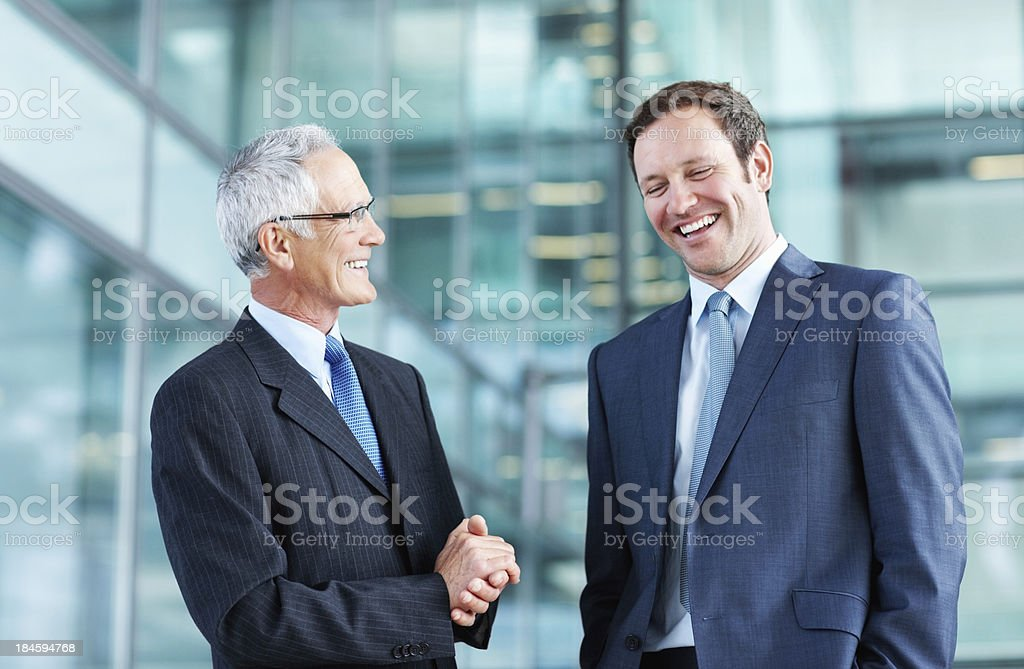 Male executives talking business stock photo