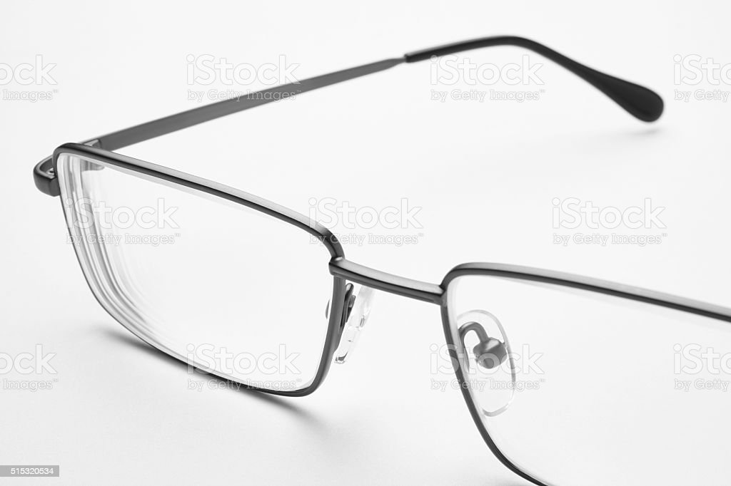 Male eyeglasses macro detail over a white background. stock photo