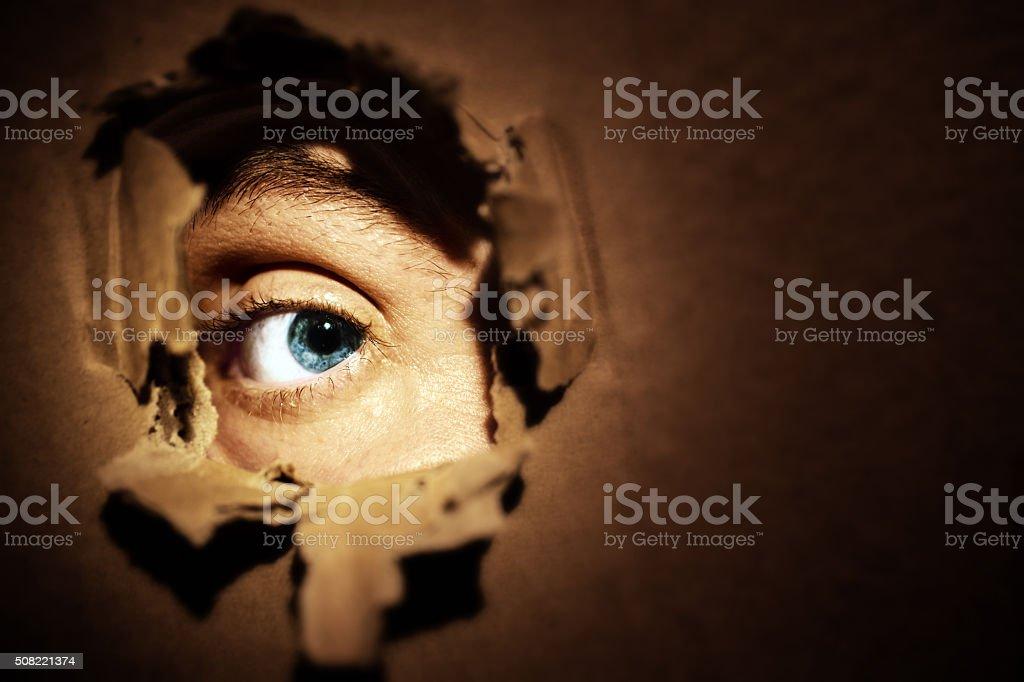Male eyes spying stock photo