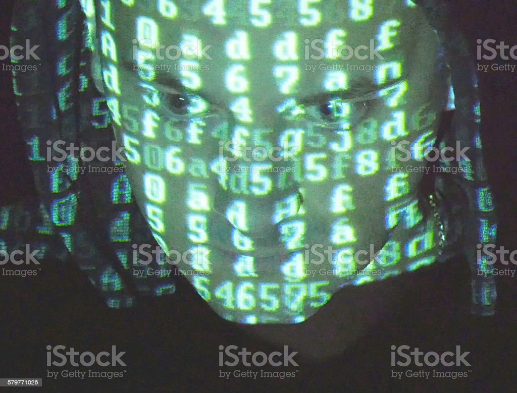 male face of hacker with binary code projections. foto de stock libre de derechos