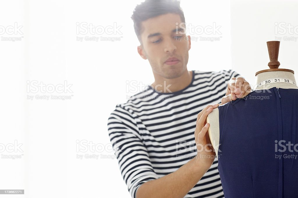 Male fashion designer working on a dress royalty-free stock photo