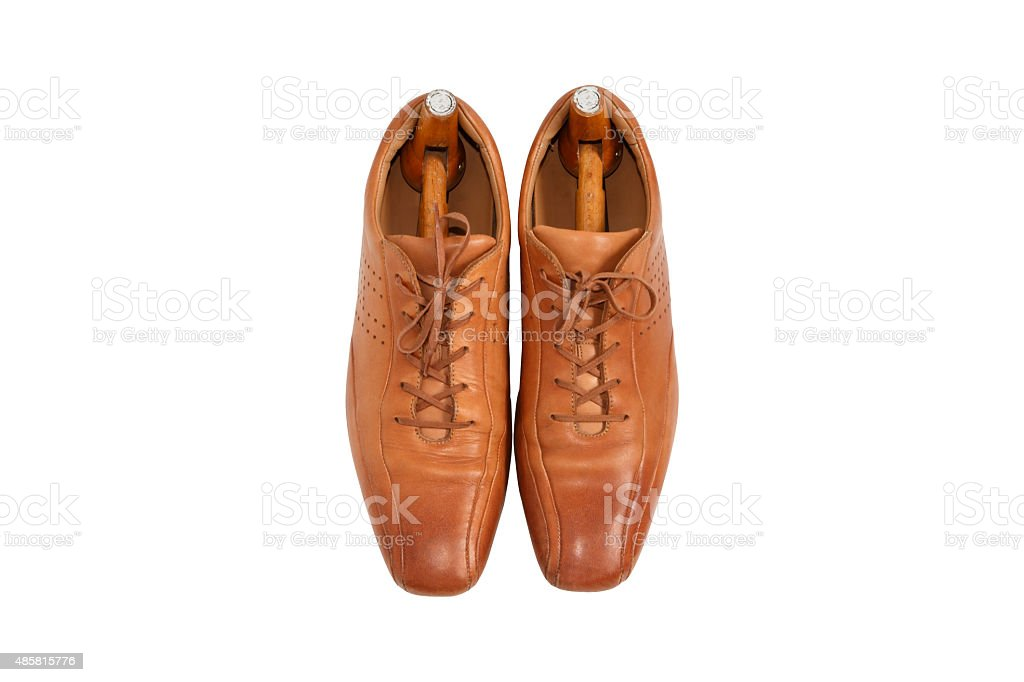 Male fashion leather shoes and shoe trees vintage style stock photo