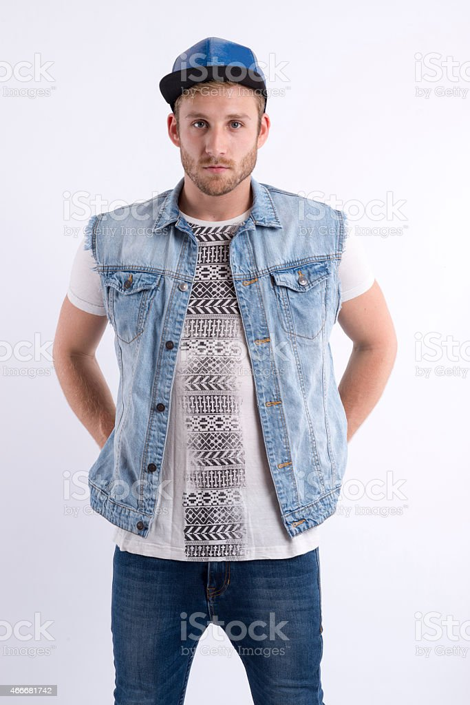 Male fashion model standing with hands on hips stock photo
