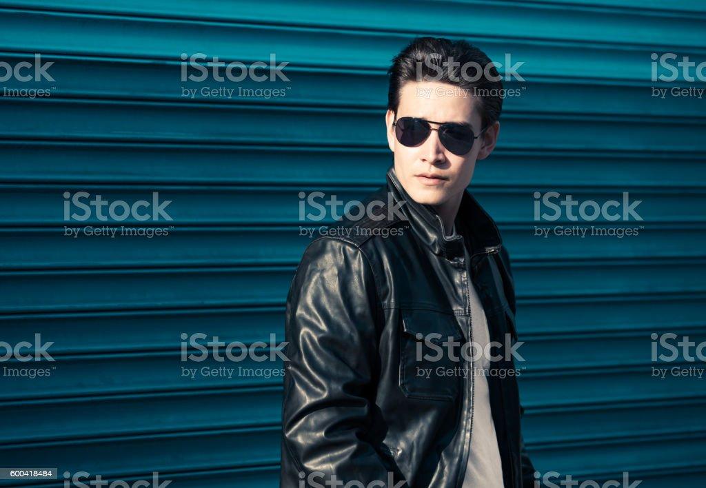 Male fashion model wearing leather jacket stock photo