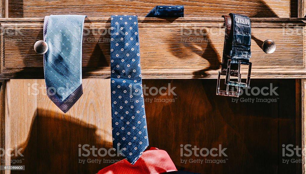 Male fashion stylish clothes in home wardrobe stock photo