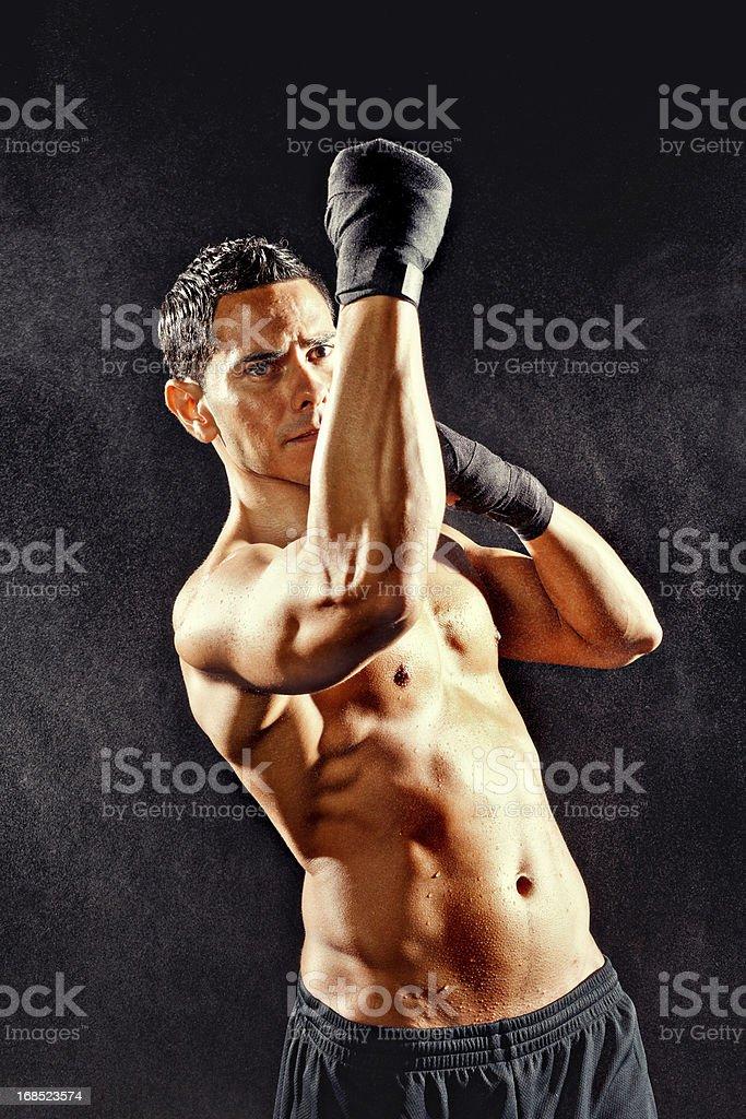 Male fighter doing an uppercut stock photo