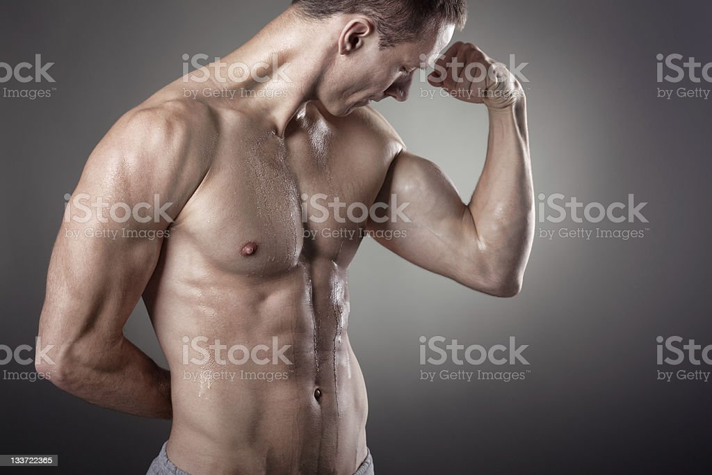 Male Figure Flexing Biceps royalty-free stock photo