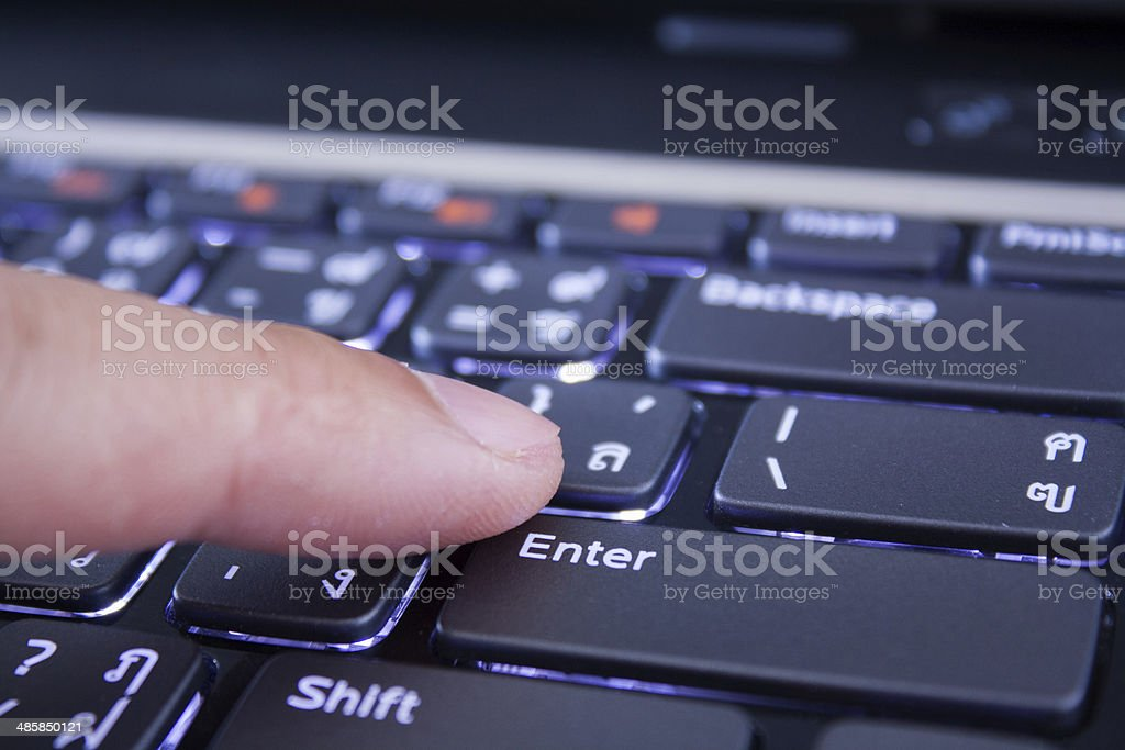 male finger is pushing the enter button royalty-free stock photo