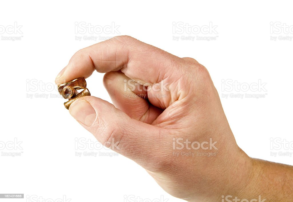 Male Fingers Pinching Three Pennies royalty-free stock photo