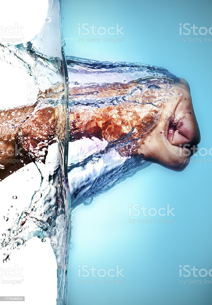 Male Fist Hitting Water stock photo