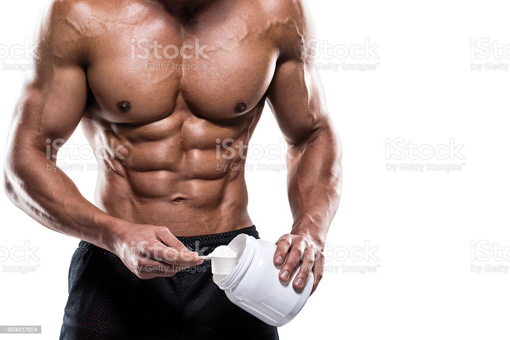 Male fitness athlete holding supplement powder stock photo