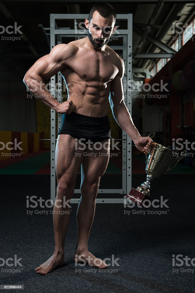 Male Fitness Competitor Showing His Winning Medal stock photo