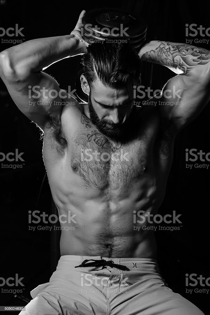 Male Fitness Model Tricep Extension stock photo