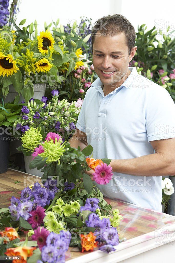 Male Florist Making Bouquet In Shop royalty-free stock photo