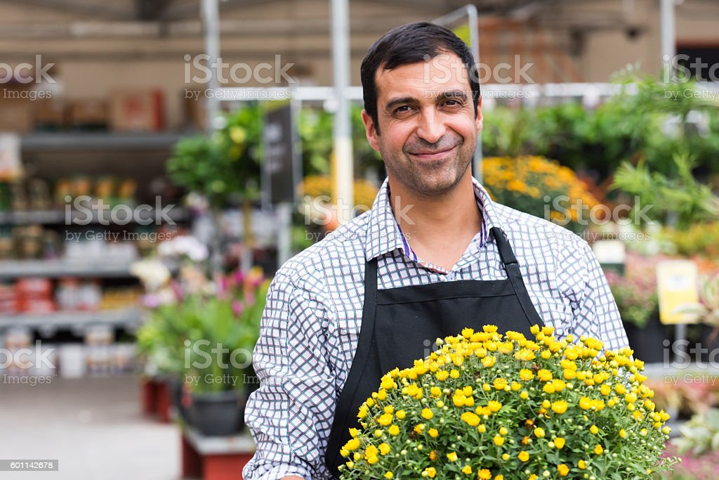 Male Florist working at a nursery stock photo