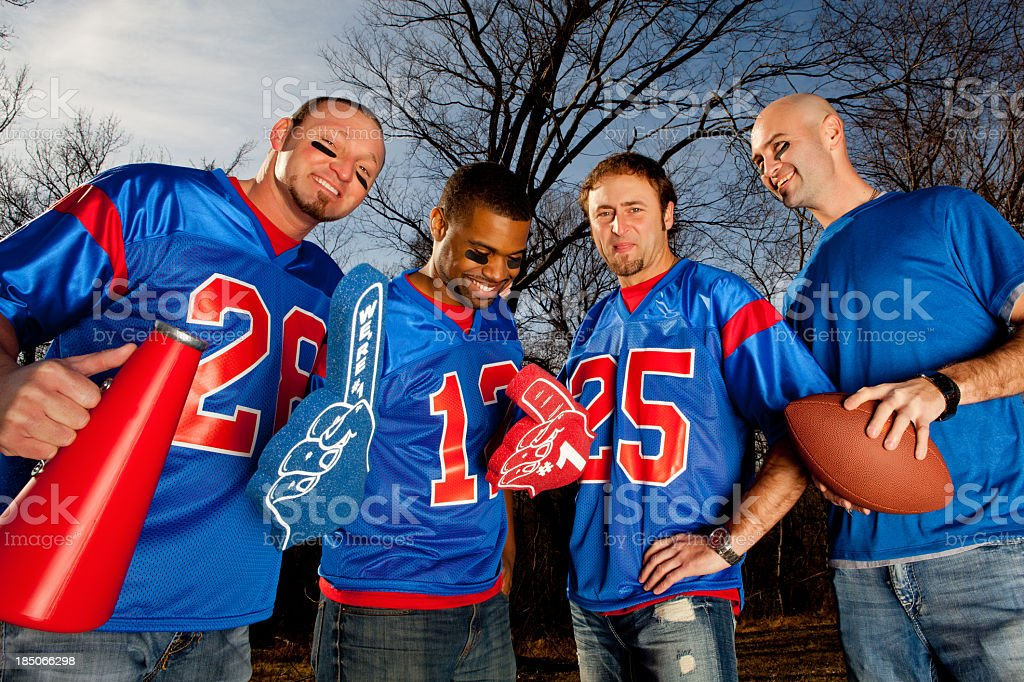 Male football fans in blue and red jerseys stock photo