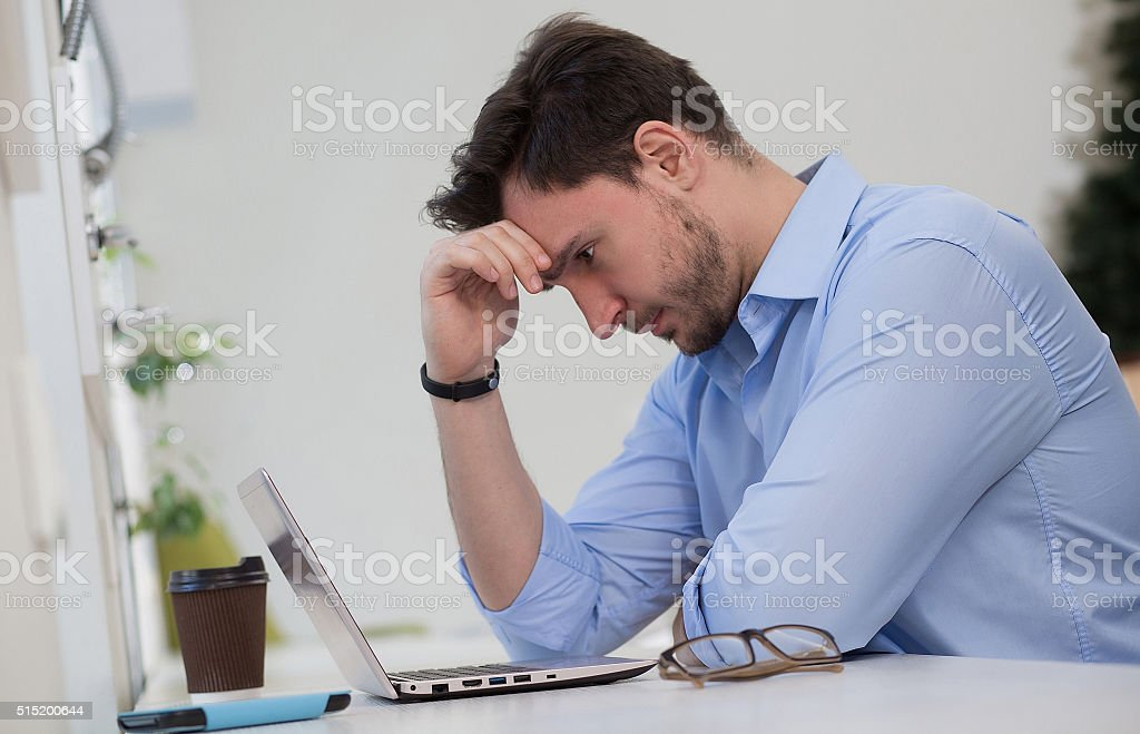 Male freelancer  thinking stock photo