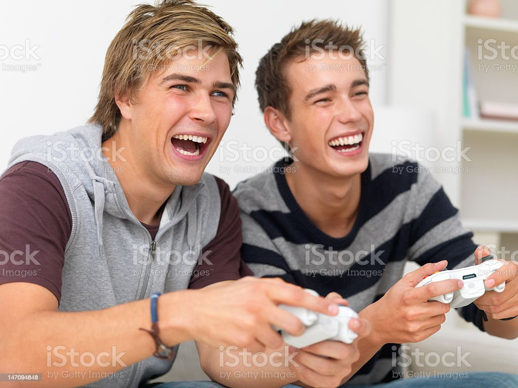 Male friends playing video game royalty-free stock photo