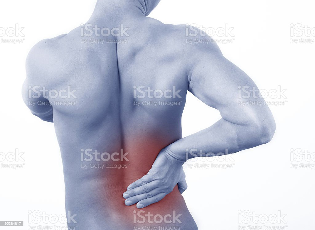 male  from behind holding hand to spot of back pain royalty-free stock photo