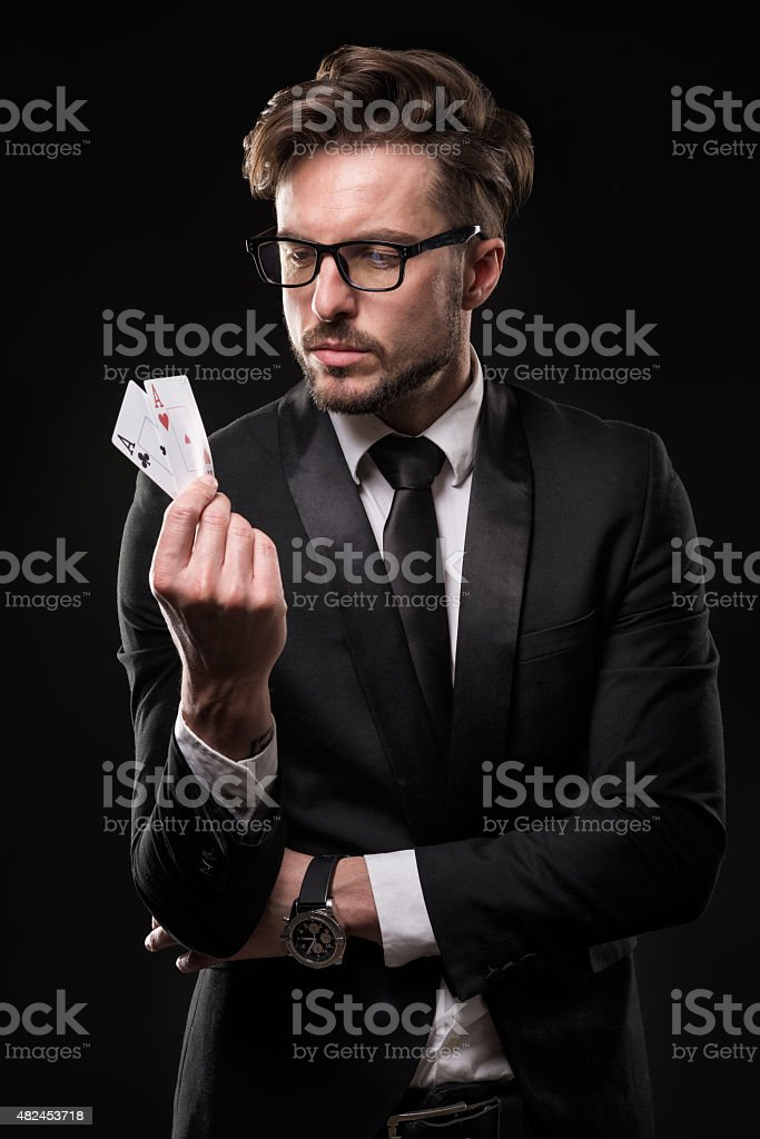 Male gambler holding aces stock photo