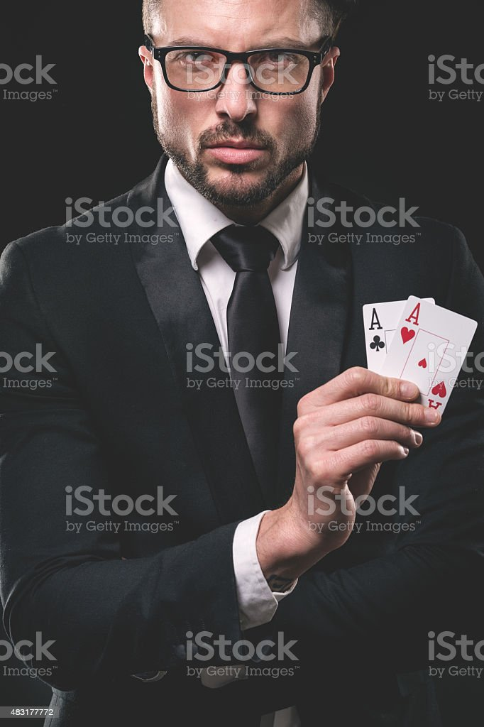 Male gambler holding pair of aces stock photo