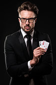 Male gambler holding pair of aces