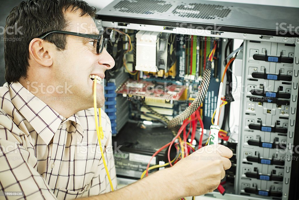 Male geek fixing his computer. royalty-free stock photo