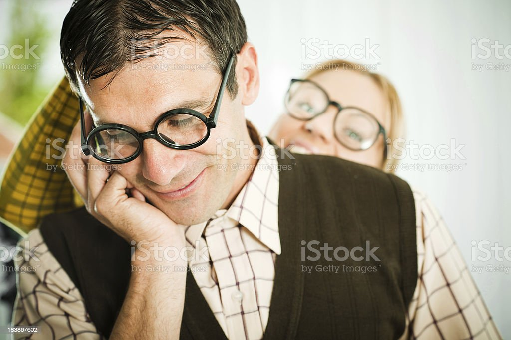 Male geek talking on the mobile phone. stock photo