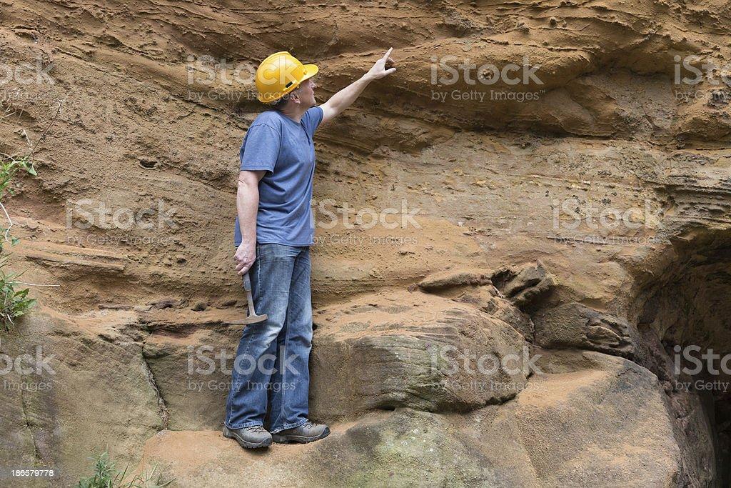 male geologist examining sandstone stock photo