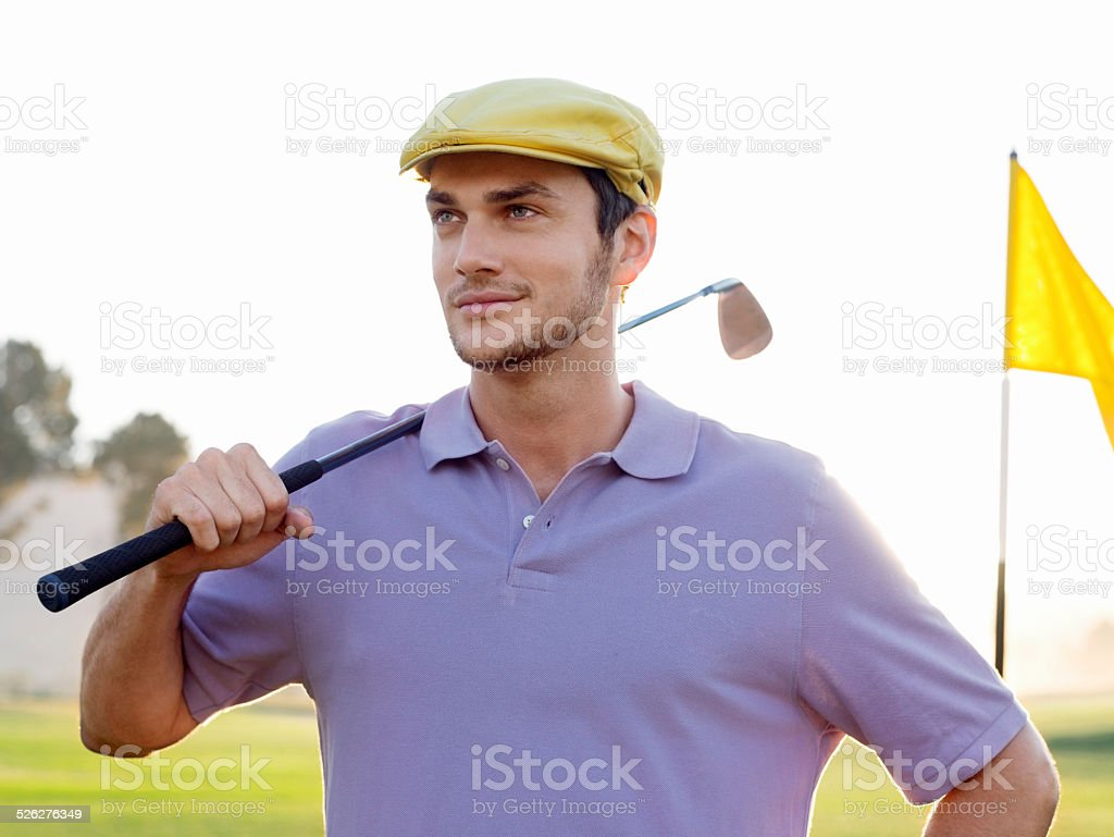 Male Golfer Holding Club On Golf Course stock photo