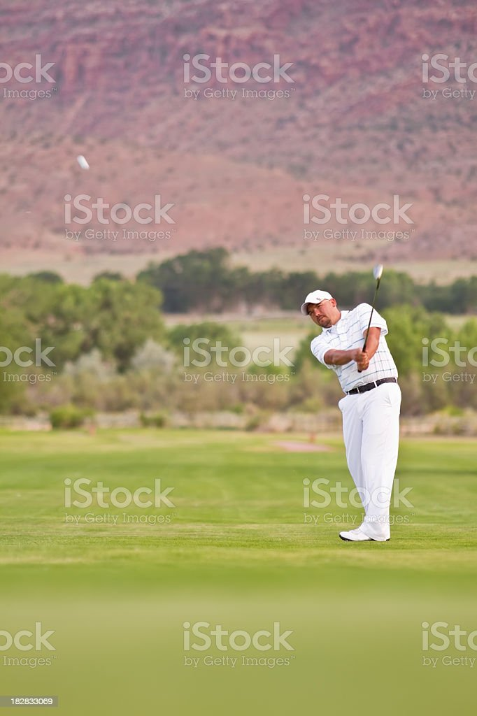 Male Golfer Making Fairway Shot royalty-free stock photo