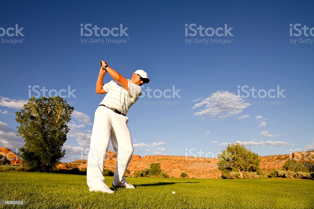 Male Golfer Making fairway shot with iron royalty-free stock photo