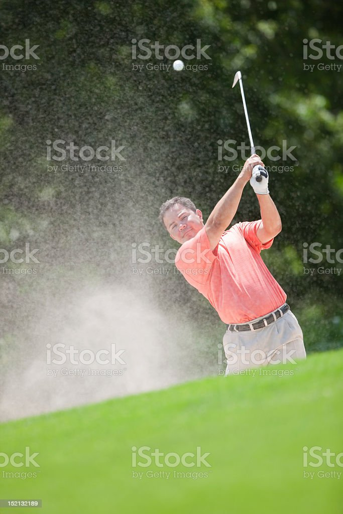 Male Golfer Making Shot Out Of Sand Trap royalty-free stock photo