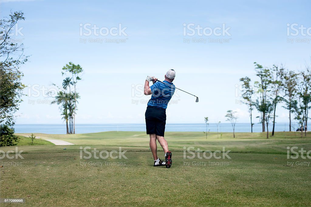 Male Golfer on the golf course stock photo