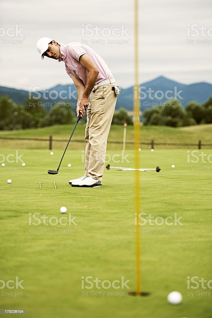 Male Golfer Practicing Putting royalty-free stock photo