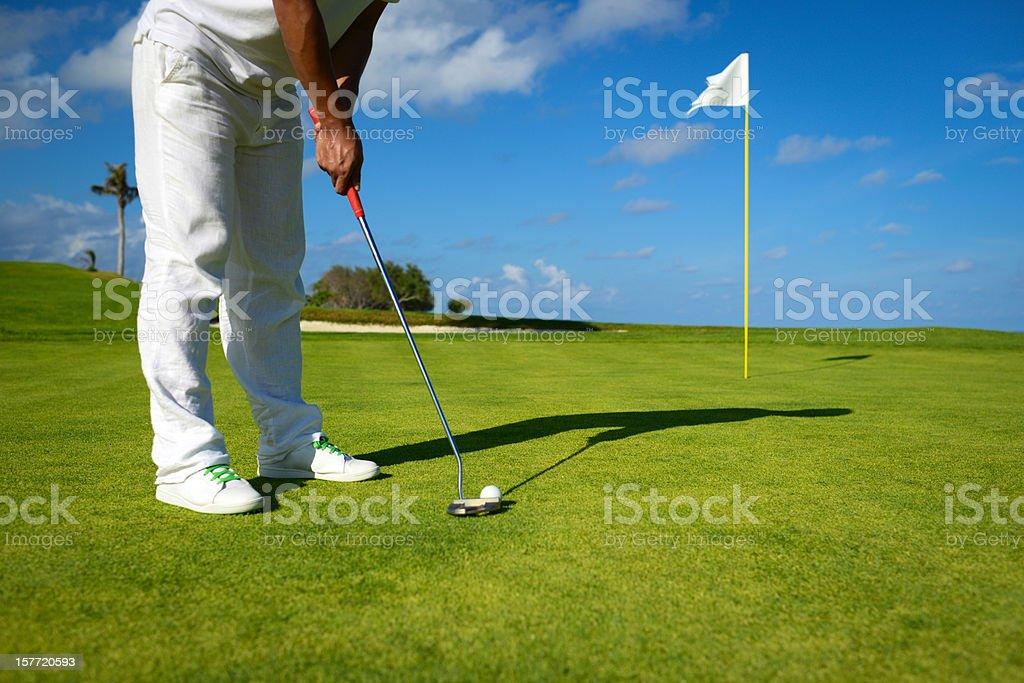 Male Golfer Putting On Golf Green stock photo