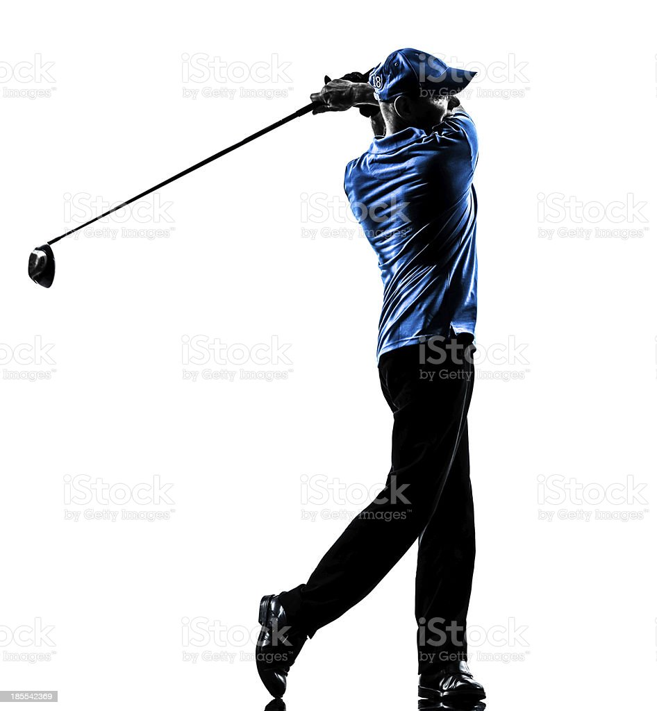 Male golfer side view finishing a swing stock photo