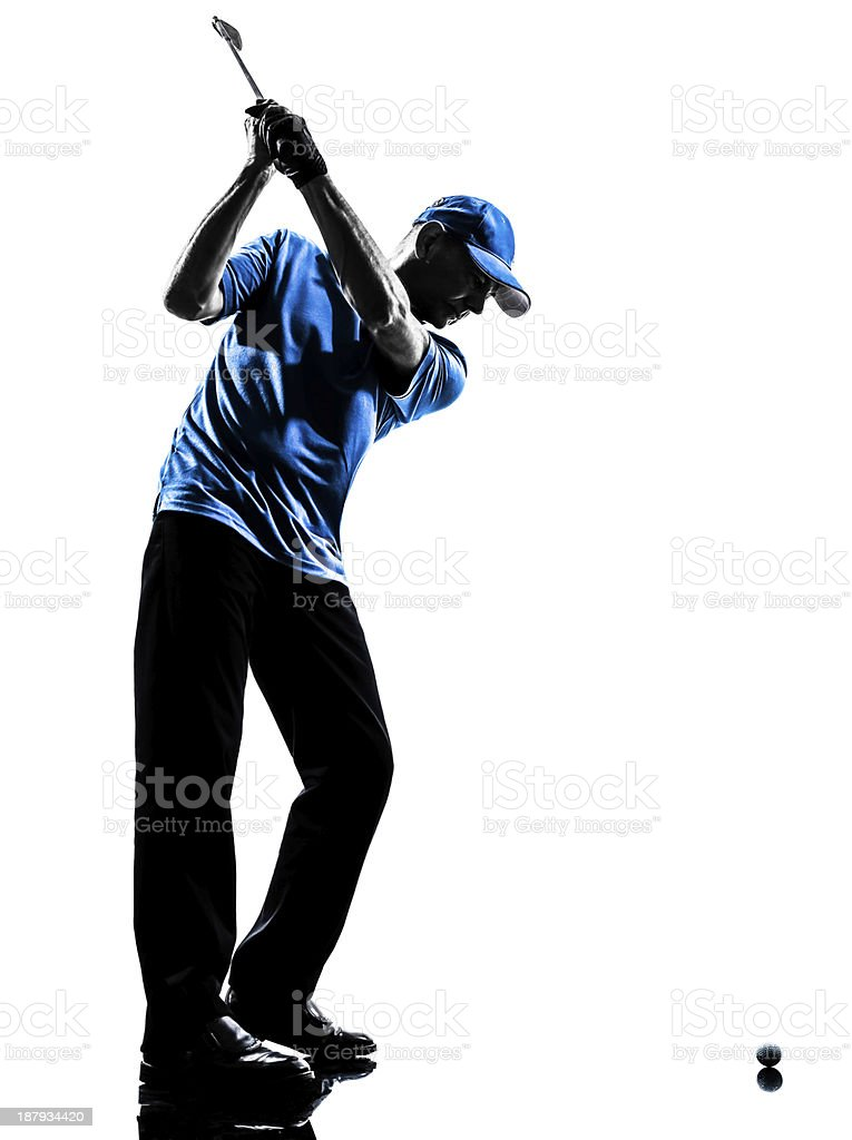 Male golfer silhouette swinging the club stock photo