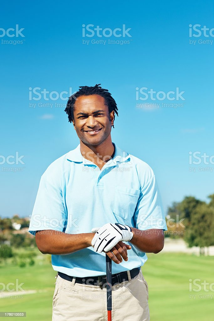 Male golfer standing at golf course royalty-free stock photo
