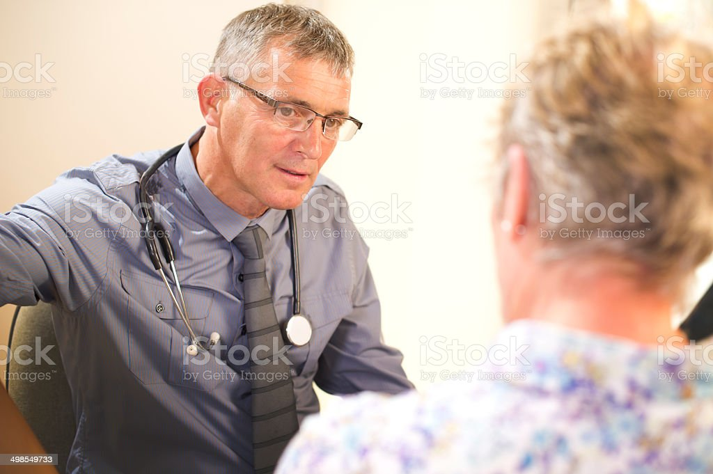 male gp with senior woman stock photo
