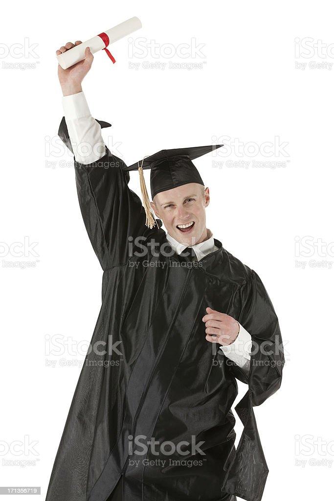 Male graduate celebrating his success stock photo