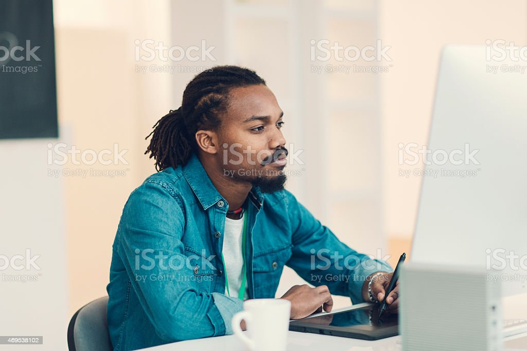 Male Graphic Designer At Work. stock photo