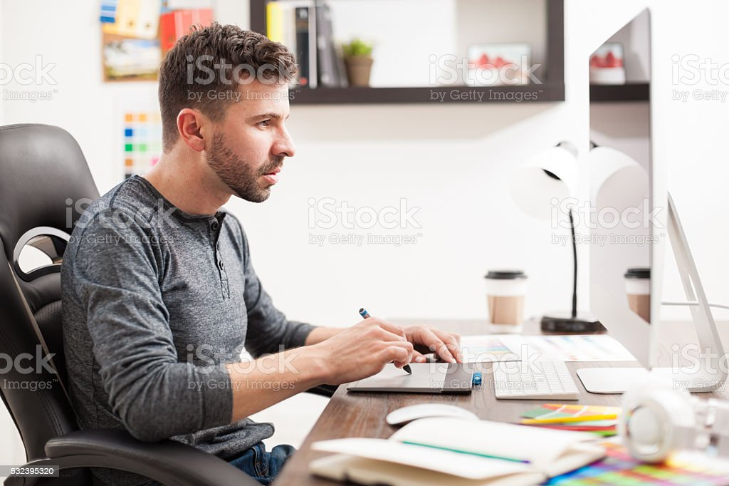 Male Interior Designers At Work male graphic designer busy at work stock photo 532395320 | istock