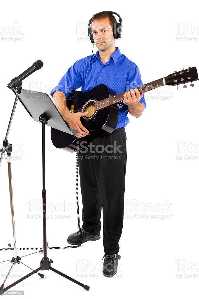 Male Guitar Player in Recording Studio stock photo
