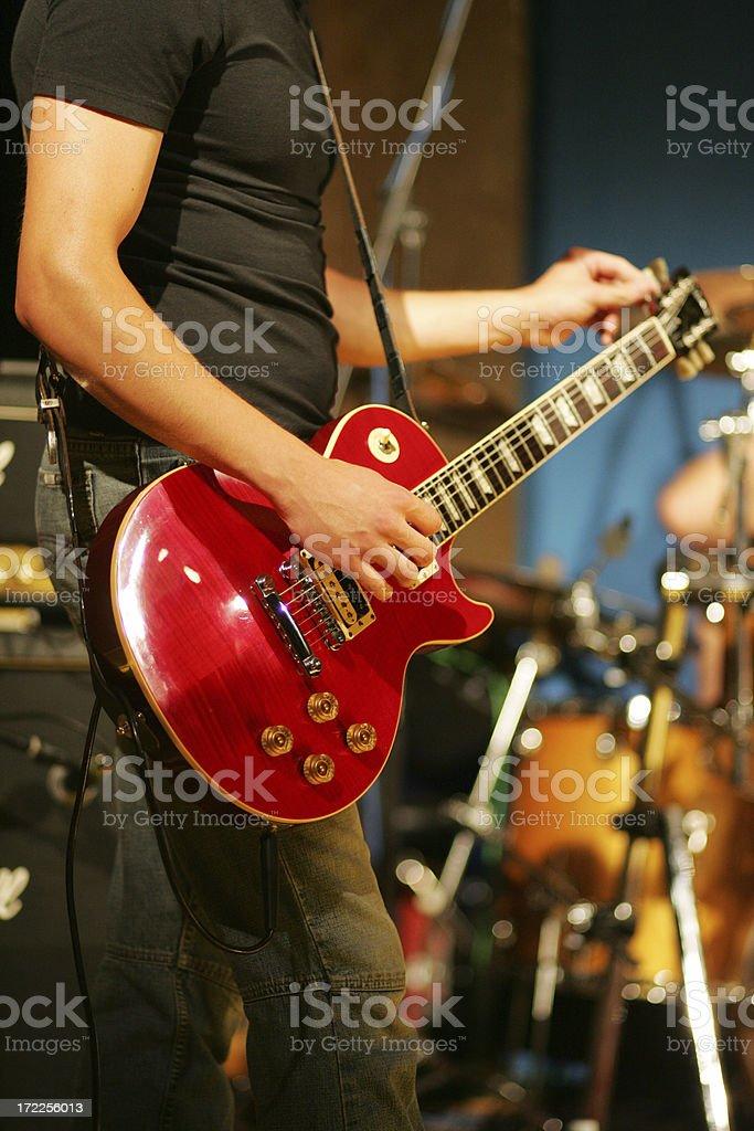 Male guitarist tuning his guitar stock photo