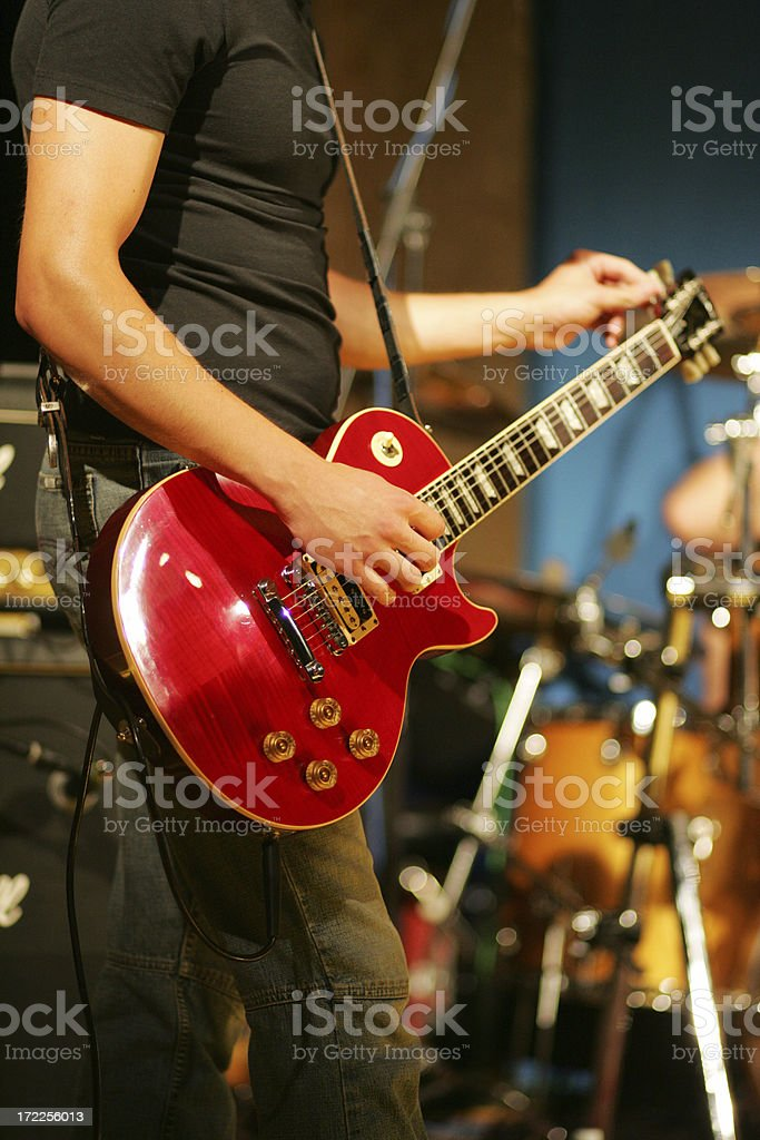 Male guitarist tuning his guitar stock photo