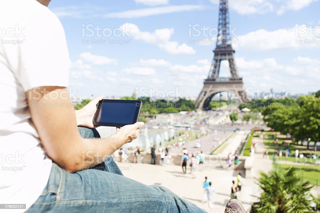 Male guy with tablet PC in front of Eiffel Tower royalty-free stock photo