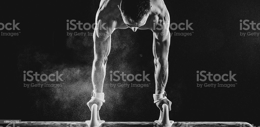 Male Gymnast doing handstand on Pommel Horse stock photo