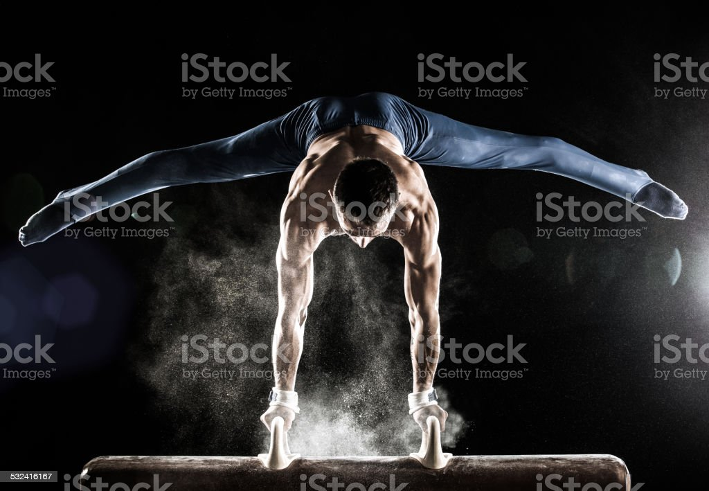 Male Gymnast doing handstand on Pommel Horse royalty-free stock photo
